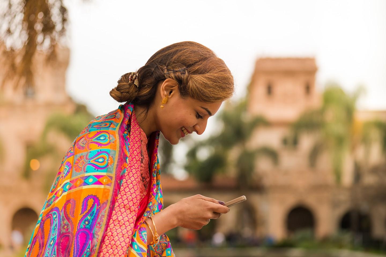 South Asian women texting